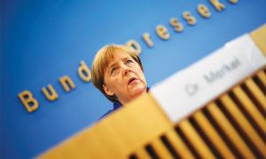 Defiant Merkel defends refugee stance after attacks