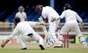 Windies bat first against India after rain delay