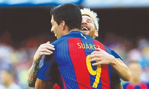 Suarez, Messi share five as Barca thump Betis