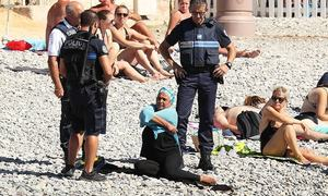 Woman forced to remove clothing on France beach after burkini ban
