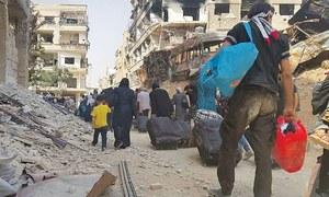 Rebels, civilians evacuate long-besieged Damascus suburb