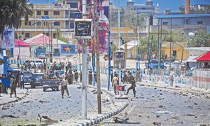 Suicide bomber hits Somalia presidential compound; 12 dead