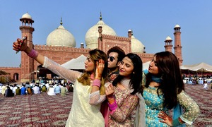 Pakistanis celebrate Eid with prayers, sacrificial animals and selfies