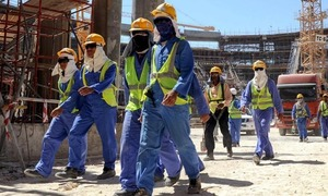 Hundreds of Qatar migrant workers 'unpaid for months'