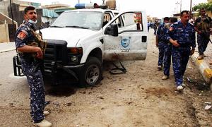Gun, suicide bomb attacks kill 12 in Iraq's Tikrit: police