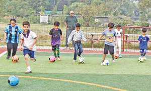 Grounds, professional facilities attract Pindi's young footballers