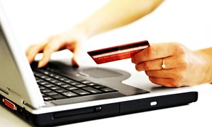 Online hotel-booking services seek to outrun travel agents