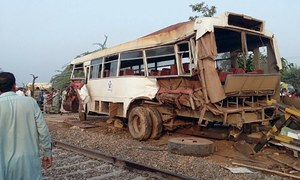 Four killed as freight train hits bus