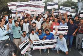 Real estate dealers protest multiple taxation