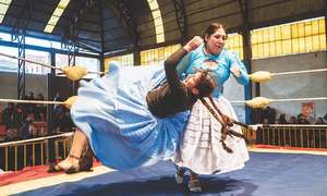 Wrestling in a dress? Yes, it is possible and these Bolivian women are proving it