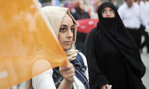 Turkey lifts military ban on Islamic headscarf