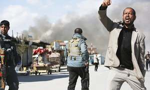 Blasts, gunfire rock Afghan capital in twin suicide attacks