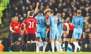 Fellaini sent off but United hold on for goalless draw at City