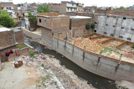 Construction continues unabated along Pindi's drains