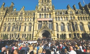 UK lowers threat level as Manchester probe advances