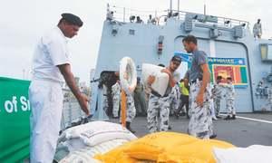 Pakistan sends aid as Lankan flood toll rises