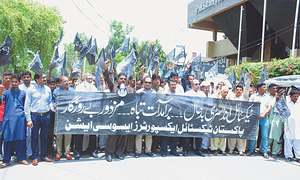 Textile mill owners, workers hold 'black day'