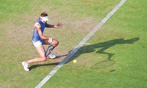 Muguruza survives scare in Birmingham opener