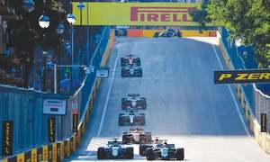 Vettel, Hamilton clash as Ricciardo wins in chaotic Baku