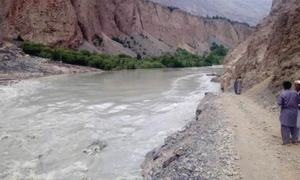 Flash flood washes away Chitral road