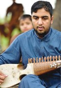 Young artist makes innovations to stringed instruments