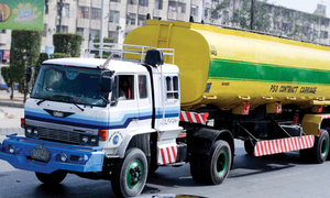 Consumers queue at petrol stations after reports of shortage in Islamabad