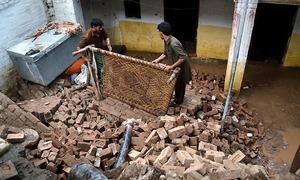 Four killed as heavy rain wreaks havoc in KP