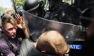 In pictures: 'Take America back' rally in Virginia turns violent