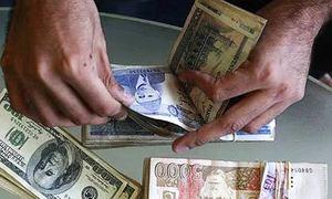 Rupee steady against dollar