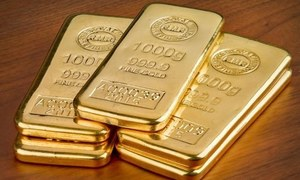 Gold slips to near four-week low