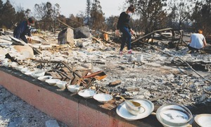 Fires force thousands more to leave their homes in California