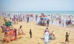 What makes Karachi's beaches so dangerous