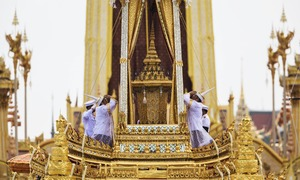 Thailand turns black and gold for late King's grand funeral