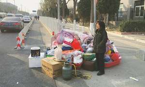 Deadly Beijing fire prompts investigation and demolitions