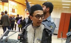 Pistols, bullets recovered from Malaysian national at Karachi airport