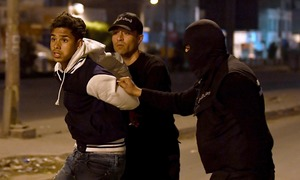 Third night of unrest in Tunisia as hundreds arrested