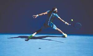 Federer shines as Wawrinka, Muguruza crash in brutal heat