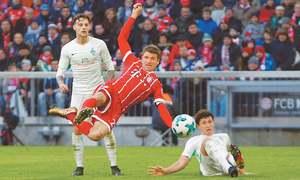 Bayern extend lead as Lewandowski, Mueller score braces
