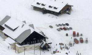 Volcanic eruption near Japanese resort triggers avalanche; one killed, several injured