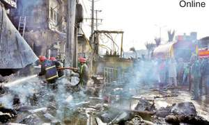 Two burnt  alive in cloth market fire