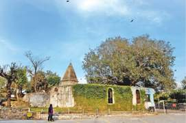Rawal Dam temple — reminiscent of a submerged village