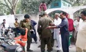 Sialkot police officer suspended after being filmed manhandling girl