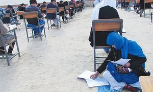 Afghan mum cradling baby during university exam goes viral