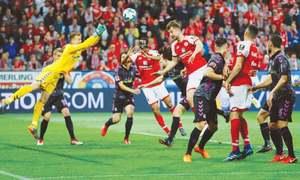Bizarre penalty helps Mainz past relegation rivals Freiburg