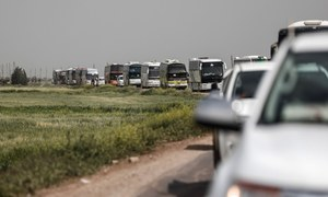 Syrian rebels withdraw from enclave, marking another victory for Assad