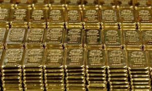 Gold hits two-week low