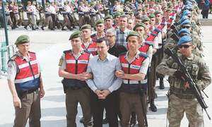 Turkish court hands life terms to 104 over coup bid