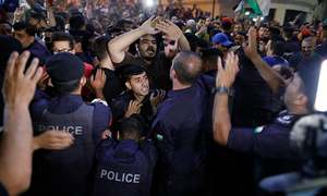Jordan king calls for review of bill that sparked protests