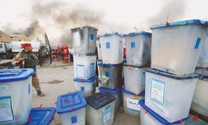 Fire hits Iraq's biggest ballot  warehouse before recount