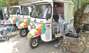 Hand-controlled rickshaws given to disabled persons